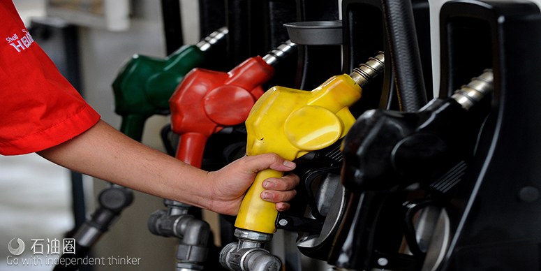 A gasoline attendant works at a gasoline station in Quezon City, suburban Manila on August 2, 2011. The Philippines plans to auction off areas of the South China Sea for oil exploration, despite worsening territorial disputes with China over the area, an official said August 2. AFP PHOTO/ JAY DIRECTO (Photo credit should read JAY DIRECTO/AFP/Getty Images)